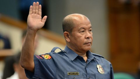 Lascanas takes his oath during a Senate hearing in Manila on October 3.