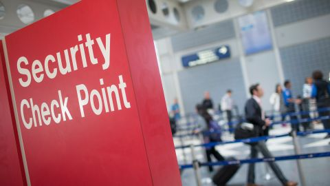 A sign directs travelers to a security checkpoint staffed by Transportation Security Administration (TSA) workers at O'Hare Airport on June 2, 2015 in Chicago, Illinois. The Department of Homeland Security said that the acting head of the TSA would be replaced following a report that airport screeners failed to detect explosives and weapons in nearly all of the tests that an undercover team conducted at airports around the country.  (Photo by Scott Olson/Getty Images)