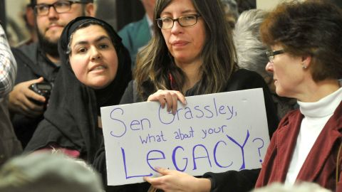 A woman holds up a sign during a U.S. Sen. Chuck Grassley (R-IA) Town Hall meeting at the Hancock County Courthouse February 21, 2017 in Garner, Iowa.