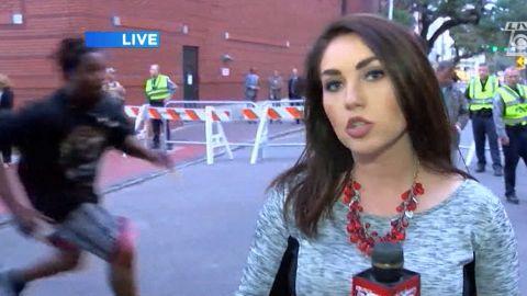Protester grabs Confederate flag live TV orig vstan dlewis_00000000.jpg