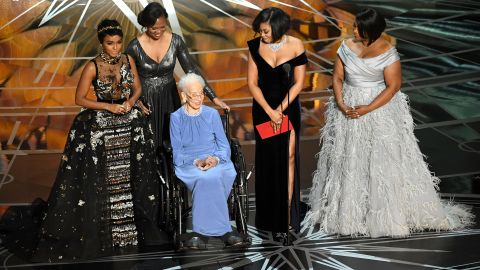 """Former NASA physicist and mathematician Katherine Johnson, third from left, appears on stage with some of the leading ladies of """"Hidden Figures"""": Janelle Monae, Taraji P. Henson and Octavia Spencer. """"Hidden Figures"""" is a true story about the unsung African-American women whose math and engineering smarts helped power the US space program in the 1960s."""