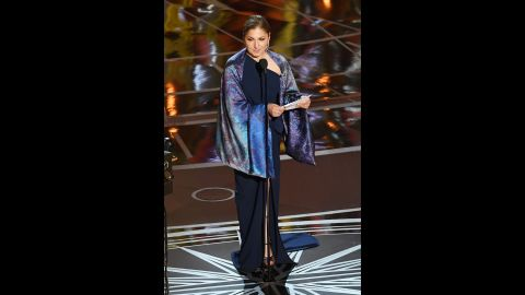 """On behalf of Iranian director Asghar Farhadi, Anousheh Ansari accepts the Oscar for best foreign language film (""""The Salesman""""). Farhadi boycotted the Oscars because of an executive order signed by US President Donald Trump. That order, which temporarily suspended the admission of refugees and barred entry to the United States from Iran and six other Muslim-majority countries, was blocked by a federal judge earlier this month."""