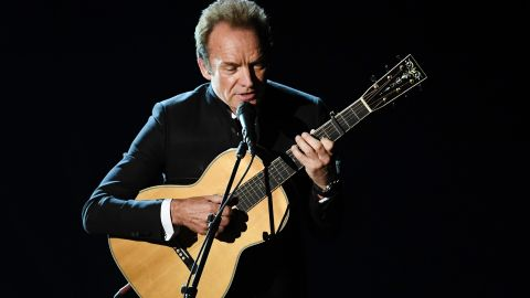 """Sting plays the guitar during a performance of """"The Empty Chair,"""" a song from """"Jim: The James Foley Story."""""""