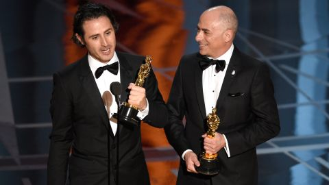 """Alan Barillaro, left, and Marc Sondheimer accept the Oscar for best animated short film  (""""Piper"""")."""