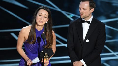 """Producer Joanna Natasegara and director Orlando von Einsiedel accept the Oscar for best documentary (short subject). """"The White Helmets"""" is about volunteer rescue workers in Syria."""