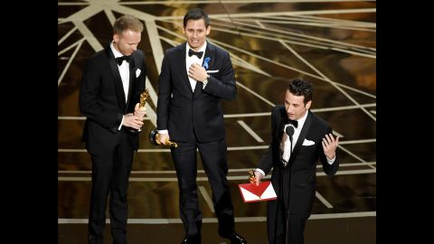 """From left, songwriters Justin Paul, Benj Pasek and Justin Hurwitz accept the Oscar for best original song (""""City of Stars"""" from the movie """"La La Land"""")."""