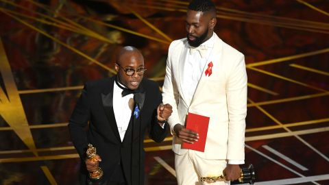 """""""Moonlight"""" director Barry Jenkins, left, and writer Tarell Alvin McCraney accept the Oscar for best adapted screenplay. The film was based on McCraney's play """"In Moonlight Black Boys Look Blue."""""""