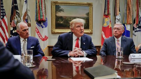 President Donald Trump, flanked by Independence Blue Cross CEO Daniel J. Hilferty, left, and Blue Cross and Blue Shield of North Carolina CEO Brad Wilson, speaks during a meeting with health insurance company executives in the Roosevelt Room of the White House in Washington, Monday, Feb. 27, 2017. (AP Photo/Pablo Martinez Monsivais)