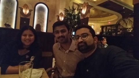 Shooting victim Srinivas Kuchibhotla (center), seen here at a Kansas City restaurant with his wife Sunayana and friend Somil Chandwani (right).