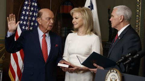 """Pence swears in new Commerce Secretary Wilbur Ross as Ross' wife, Hilary, stands by on Tuesday, February 28. The billionaire <a href=""""http://money.cnn.com/2017/02/27/investing/wilbur-ross-commerce-secretary-confirmation-senate/"""" target=""""_blank"""">was confirmed by the Senate</a> by a vote of 72-27."""