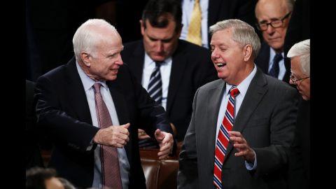 US Sen. John McCain, left, talks with US Sen. Lindsey Graham before Trump arrived.