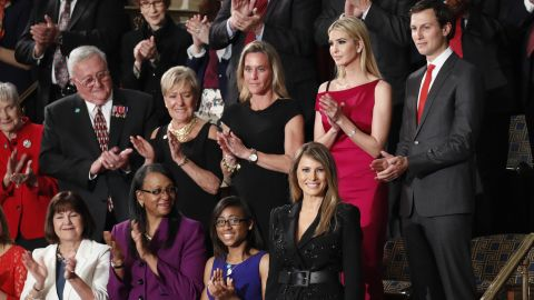 First lady Melania Trump, bottom right, is applauded as she arrives in the chamber.