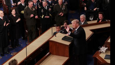 The President waves before starting his speech.
