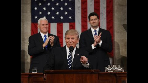 Trump is applauded after arriving in the House chamber.