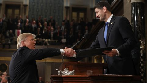 Trump shakes hands with Ryan before starting.