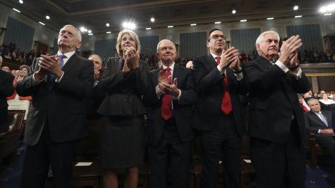 Members of Trump's Cabinet applaud the President. From left are Defense Secretary James Mattis, Education Secretary Betsy DeVos, Attorney General Jeff Sessions, Treasury Secretary Steve Mnuchin and Secretary of State Rex Tillerson.
