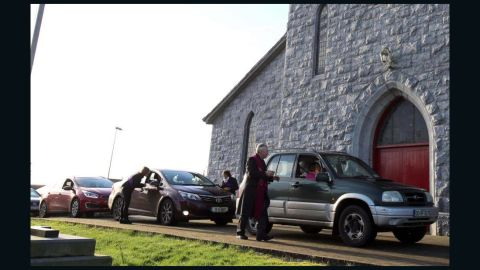 Father Paddy Mooney distributes ashes to parishioners on Ash Wednesday.