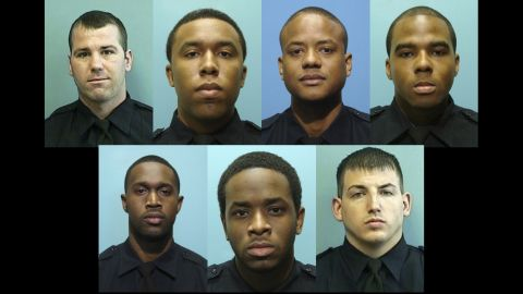 These undated photos provided by the Baltimore Police Department show, from left, Daniel Hersl, Evodio Hendrix, Jemell Rayam, Marcus Taylor, Maurice Ward, Momodu Gando and Wayne Jenkins, the seven police officers who are facing charges of robbery, extortion and overtime fraud, and are accused of stealing money and drugs from victims, some of whom had not committed crimes.
