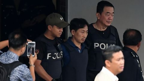 North Korean national Ri Jong Chol is escorted with a heavy police presence as he leaves the Sepang police headquaters in Sepang on March 3, 2017. The only North Korean arrested over the dramatic airport assassination of Kim Jong-Nam is to be deported, Malaysia said on March 2, as it announced the abrupt cancellation of a visa-waiver programme with Pyongyang.