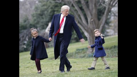President Trump walks with his grandchildren Arabella and Joseph across the South Lawn of the White House on Friday, March 3. They were about to board Marine One for a short flight to Andrews Air Force Base.