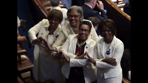 """From left, US Reps. Brenda Lawrence, Joyce Beatty, Marcia Fudge and Val Demings pose for a photo before Trump's address to Congress on Tuesday, February 27. Many Democrats wore white as a nod to <a href=""""http://www.cnn.com/2016/08/18/politics/gallery/tbt-womens-suffrage/index.html"""" target=""""_blank"""">the women's suffrage movement.</a>"""
