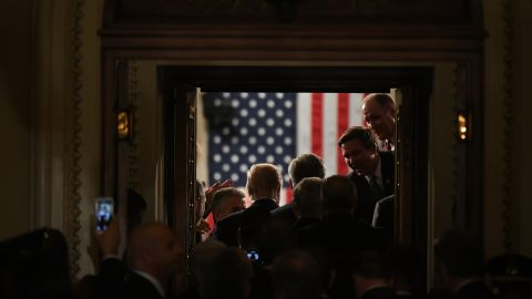 """President Trump stands in the doorway of the House chamber while being introduced for his speech to Congress. <a href=""""http://www.cnn.com/2017/02/25/politics/gallery/week-in-politics-0226/index.html"""" target=""""_blank"""">See last week in politics</a>"""