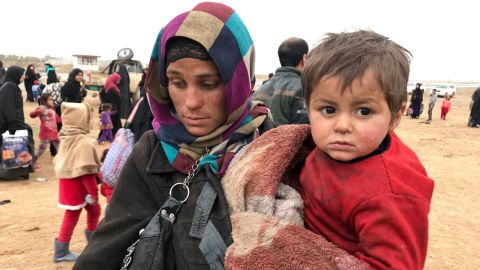 A woman from west Mosul carries her child and the few possessions she could gather before escaping the city. By Saturday the Iraqi government estimated that nearly 50,000 people had fled western Mosul to government-controlled territory. They end up in refugee camps hastily set up around the city by the government and local and international relief groups.
