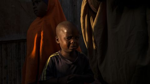 A young Somali boy grieves for his mother, who had died in a camp for displaced people