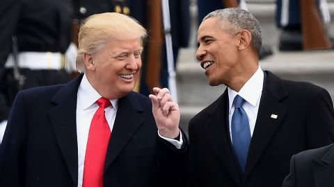 US President Donald Trump and former President Barack Obama talk on the East front steps of the US Capitol after inauguration ceremonies on January 20, 2017 in Washington, DC.
