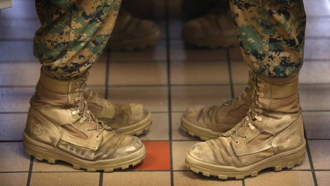 PARRIS ISLAND, SC - FEBRUARY 26:  Female Marine recruits sit with their feet at a 45 degree angle, the same angle they are at while standing at the position of attention, while having lunch during boot camp on February 26, 2013 at MCRD Parris Island, South Carolina. Female enlisted Marines have gone through recruit training at the base since 1949. About 11 percent of female recruits who arrive at the boot camp fail to complete the training, which can be physically and mentally demanding. On January 24, 2013 Secretary of Defense Leon Panetta rescinded an order, which had been in place since 1994, that restricted women from being attached to ground combat units.  (Photo by Scott Olson/Getty Images)