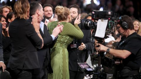 """Singer Adele kisses Simon Konecki during the Grammy Awards in February 2017. <a href=""""http://www.cnn.com/2017/03/05/entertainment/adele-confirms-marriage/index.html"""">Adele  confirmed during a concert in Brisbane, Australia, </a>that she and Konecki are married."""