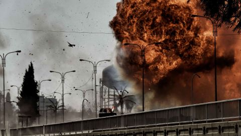Flames billow from an explosion in Mosul during a clash between Iraqi forces and ISIS fighters on Sunday, March 5.