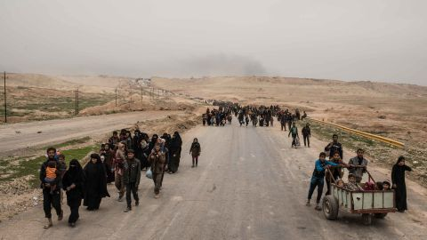 """Families are forced to evacuate as Iraqi forces advance in western Mosul on Thursday, March 2. The <a href=""""http://www.cnn.com/2017/03/05/middleeast/number-of-iraqis-fleeing-mosul-nears-60000/"""">number of internally displaced people has surged</a> as the offensive effort has intensified."""