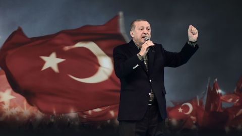"""Turkish President Recep Tayyip Erdogan gestures as he delivers a speech on stage, on March 5, 2017 in Istanbul during a pro-government women meeting. Some 12,000 women filled on March 5 an Istanbul arena in support of a """"Yes"""" vote in an April referendum whether to boost Turkish President Recep Tayyip Erdogan's powers. Erdogan lashed out at Germany for blocking several rallies there ahead of an April vote in Turkey on boosting his powers as head of state, likening them to Nazi practices. """"Your practices are not different from the Nazi practices of the past,"""" Erdogan told a women's rally in Istanbul as Turks vote on April 16 whether to approve changes to the constitution expanding presidential powers.  / AFP PHOTO / OZAN KOSE        (Photo credit should read OZAN KOSE/AFP/Getty Images)"""