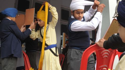 Young Indian Sikhs participate in a turban tying competition in 2014.