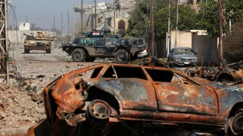 Iraqi security forces advance during the fighting in western Mosul on Mondau.