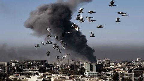 Smoke rises following an airstrike in western Mosul during the offensive Monday.
