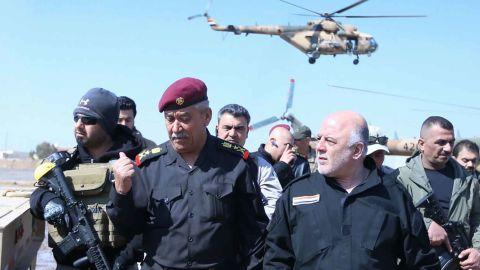 Iraqi Prime Minister Haidar al-Abadi, right, meets Iraqi forces in Mosul Tuesday.