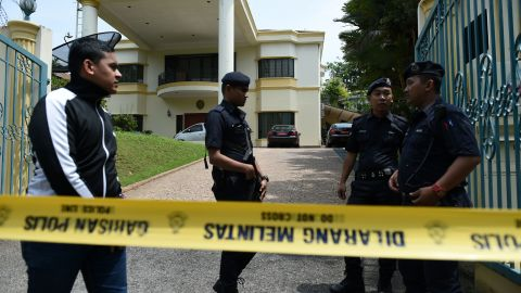 Royal Malaysian Police personnel keep watch behind a police line drawn across the entrance to the North Korean embassy in Kuala Lumpur on March 7, 2017, following a directive barring North Korean embassy staff from leaving the country.  Malaysia said March 7 that North Korea embassy staff are barred from leaving the country, in a tit for tat response after Pyongyang banned all Malaysian citizens from leaving.  / AFP PHOTO / MOHD RASFAN        (Photo credit should read MOHD RASFAN/AFP/Getty Images)