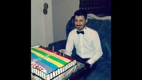 Zigorat on his birthday with a rainbow flag cake.
