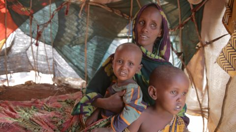Fatuma Hassan Hussein sits with her two children Shankaron, 3, and Rahma, 15 months, in a makeshift shelter in Baidoa, Somalia. Fatuma says she was having trouble feeding her family. She says she traveled more than a hundred miles to get to a camp in Baidoa, Somalia.