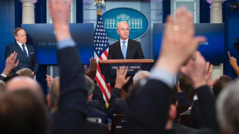 White House Press Secretary Sean Spicer (L) looks on as US Secretary of Health and Human Service Tom Price (C) takes questions during the daily briefing at the White House in Washington, DC on March 7, 2017. / AFP PHOTO / JIM WATSON        (Photo credit should read JIM WATSON/AFP/Getty Images)