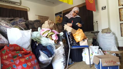 A volunteer sorts out donated medicines at the Evangelical Church in Ismailia.