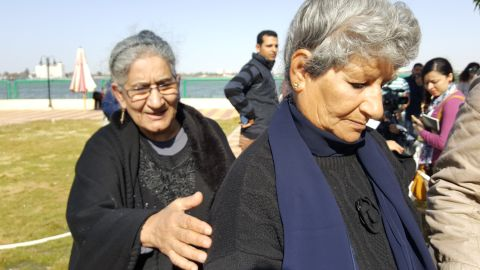 Nabila Halim, pictured right, is consoled by her sister at a government hostel in Ismailia.
