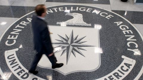 A man crosses the Central Intelligence Agency (CIA) logo in the lobby of CIA Headquarters in Langley, Virginia, on August 14, 2008.