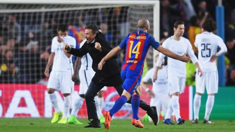 PSG players look dejected as Barca's coach Luis Enrique celebrates with Javier Mascherano.