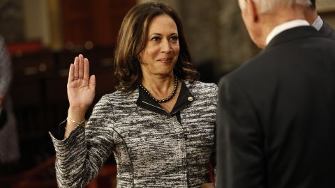 WASHINGTON, DC - JANUARY 3: U.S. Sen. Kamala Harris (D-CA) participates in a reenacted swearing-in with U.S. Vice President Joe Biden in the Old Senate Chamber at the U.S. Capitol January 3, 2017 in Washington, DC. Earlier in the day Biden swore in the newly elected and returning members on the Senate floor. (Photo by Aaron P. Bernstein/Getty Images)