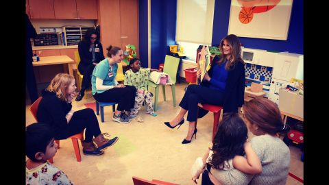 """The first lady's Twitter account posted this photo of Trump reading a book to children at New York-Presbyterian Hospital. """"Honoring children #worldbookday,"""" <a href=""""https://twitter.com/FLOTUS/status/837417717133111297"""" target=""""_blank"""" target=""""_blank"""">the tweet said in March 2017.</a>"""