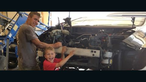 J.T. Parker, 8, seen here with big brother Mason, saved their father after a Toyota Prius fell on him.