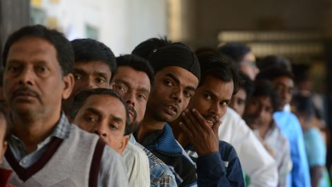 Indian voters wait in line at a polling station in the Naini area on the outskirts of Allahabad during the fourth phase of Uttar Pradesh state assembly elections on February 23.